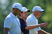 Mike Weir of Canada gestures towards Tiger Woods of USA during a practice round of the World Golf Championship Bridgestone Invitational on August 5, 2009 at Firestone Country Club in Akron, Ohio.