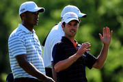 Mike Weir of Canada gestures towards Tiger Woods of the U.S. during a practice round of the World Golf Championship Bridgestone Invitational on August 5, 2009 at Firestone Country Club in Akron, Ohio.