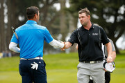 (R-L) Marc Leishman of Australia shakes hands with Gary Woodland after Woodland won 2&1 on the 17th hole during round four of the World Golf Championships Cadillac Match Play at TPC Harding Park on May 2, 2015 in San Francisco, California.