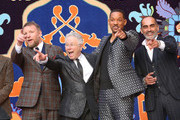"(L-R) Director Guy Ritchie, Composer Alan Menken, Will Smith and Navid Negahban attend the World Premiere of Disney?s ""Aladdin"" at the El Capitan Theater in Hollywood CA on May 21, 2019, in the culmination of the film?s Magic Carpet World Tour with stops in Paris, London, Berlin, Tokyo, Mexico City and Amman, Jordan."