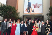 (L-R) President of Walt Disney Studios Motion Picture Production, Sean Bailey, screenwriters Alex Ross Perry, Allison Schroeder, producer Kristin Burr, actor Jim Cummings, executive producer Renee Wolfe, actor Brad Garrett, director Marc Forster, actors Ewan McGregor, Bronte Carmichael, Hayley Atwell, songwriter Richard M. Sherman, producer Brigham Taylor and VP production at Walt Disney Pictures, Jessica Virtue attend the world premiere of Disney's 'Christopher Robin' at the Main Theater on the Walt Disney Studios lot in Burbank, CA on July 30, 2018.