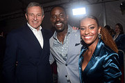 """(L-R) The Walt Disney Company Chairman and CEO Bob Iger, Actor Sterling K. Brown, and Ryan Michelle Bathe attends the world premiere of Disney's """"Frozen 2"""" at Hollywood's Dolby Theatre on Thursday, November 7, 2019 in Hollywood, California."""