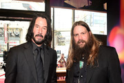 (L-R) Keanu Reeves and Chris Stapleton attend the world premiere of Disney and Pixar's TOY STORY 4 at the El Capitan Theatre in Hollywood, CA on Tuesday, June 11, 2019.