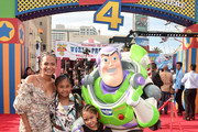 Christina Milian (L) and family attend the world premiere of Disney and Pixar's TOY STORY 4 at the El Capitan Theatre in Hollywood, CA on Tuesday, June 11, 2019.