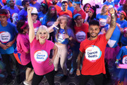Kimberly Wyatt and Aston Merrygold help break the World Record Dance Marathon Relay as part of the Tesco Dance Beats Fundraiser at Wembley Stadium on July 20, 2019 in London, England.