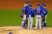 Jon Lester #34 of the Chicago Cubs walks to the dugout after being relieved during the eighth inning against the Cleveland Indians in Game Seven of the 2016 World Series at Progressive Field on November 2, 2016 in Cleveland, Ohio.