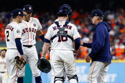 Manager A.J. Hinch #14 of the Houston Astros walks to the mound to pull Dallas Keuchel #60 from the game as Brian McCann #16, Alex Bregman #2 and Carlos Correa #1 look on against the Los Angeles Dodgers in game five of the 2017 World Series at Minute Maid Park on October 29, 2017 in Houston, Texas.