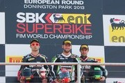 (L-R) Sylvain Guintoli of France and Aprilia Racing Team, Tom Sykes of Great Britain and Kawasaki Racing Team and Eugene Laverty of Ireland and Aprilia Racing Team pose on the podium after race 2 of the World Superbikes - Race during the round five of 2013 Superbikes FIM World Championship at Donington Park on May 26, 2013 in Castle Donington, England.