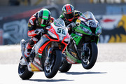 Tom Sykes (#66) of Great Britain on the Kawasaki ZX-10R for Kawasaki Racing Team and Eugene Laverty (#58) of Ireland on the Aprilia RSV4 for the Aprilia Racing Team battle for position during the World Superbikes Race 2 at TT Circuit Assen on April 28, 2013 in Assen, Netherlands.