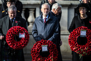 Leader of the Labour Party Jeremy Corbyn (C) and British Prime Minister Theresa May (R) hold their wreaths during the annual Remembrance Sunday memorial at the Cenotaph on Whitehall on November 11, 2018 in London, England. The armistice ending the First World War between the Allies and Germany was signed at Compiègne, France on eleventh hour of the eleventh day of the eleventh month - 11am on the 11th November 1918. This day is commemorated as Remembrance Day with special attention being paid for this year's centenary.