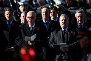 (L-R) Secretary of State for Defence Gavin Williamson and Former British Prime Ministers David Cameron and Gordon Brown sing a hymn as they stand behind Leader of the Liberal Democrats Vince Cable and Ian Blackford during the annual Remembrance Sunday memorial at the Cenotaph on Whitehall on November 11, 2018 in London, England. The armistice ending the First World War between the Allies and Germany was signed at Compiègne, France on eleventh hour of the eleventh day of the eleventh month - 11am on the 11th November 1918. This day is commemorated as Remembrance Day with special attention being paid for this year's centenary.