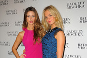 Katherine Webb (L) and Erin Heatherton attend Badgley Mischka with Yappn Corp Brings Fotoyapp To Mercedes-Benz Fashion Week at Lincoln Center on September 9, 2014 in New York City.