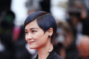"""Singer Li Yuchun attends the screening of """"Yomeddine"""" during the 71st annual Cannes Film Festival at Palais des Festivals on May 9, 2018 in Cannes, France."""