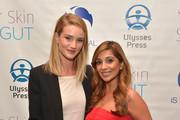"Rosie Huntington-Whiteley (L) and author Dr. Nigma Talib attend the ""Younger Skin Starts In The Gut"" book launch party at Four Seasons Hotel Los Angeles at Beverly Hills on March 22, 2016 in Los Angeles, California."