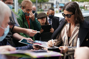 Actress Juliette Binoche signs autographs upon her arrival for  the ZFF Masters during the 16th Zurich Film Festival at Filmpodium on October 01, 2020 in Zurich, Switzerland.