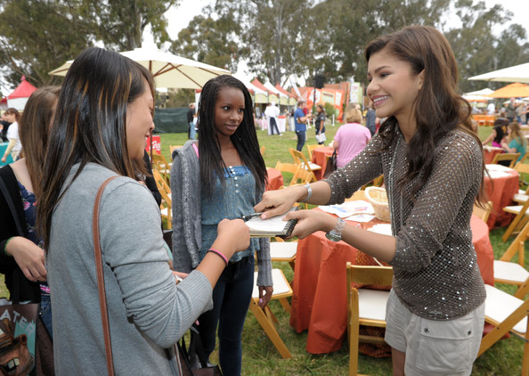 Zendaya Coleman Actress Zendaya Coleman (R) signs autographs in the Kits for Kids area during the 22nd Annual Time for Heroes Celebrity Picnic sponsored by Disney to benefit the Elizabeth Glaser Pediatric AIDS Foundation at Wadsworth Theater on the Veteran Administration Lawn on June 12, 2011 in Los Angeles, California.
