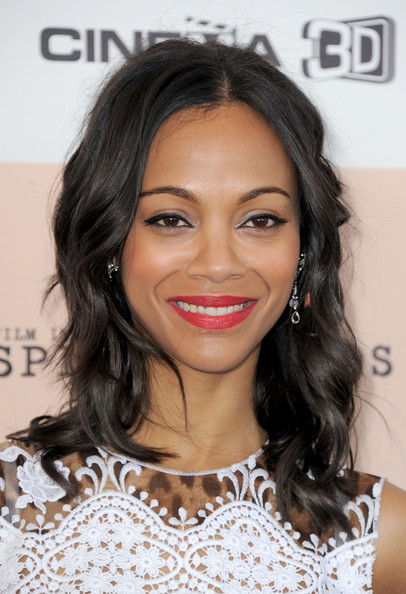 Zoe Saldana Actress Zoe Saldana wearing Piaget arrives at the 2011 Film Independent Spirit Awards at Santa Monica Beach on February 26, 2011 in Santa Monica, California.