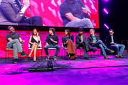 """Ruben Fleischer , Zoey Deutch, Jesse Eisenberg, Rosario Dawson, Avan Jogia, Paul Wernick  and Rhett Reese on stage at a """"Zombieland 2"""" Panel and Surprise Screening at Los Angeles Convention Center on October 12, 2019 in Los Angeles, California."""