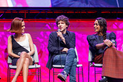 """Actors Zoey Deutch, Jesse Eisenberg and Rosario Dawson on stage at a """"Zombieland 2"""" Panel and Surprise Screening at Los Angeles Convention Center on October 12, 2019 in Los Angeles, California."""