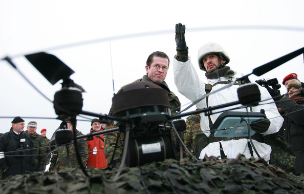 Karl-theodor Zu Guttenberg German Defence Minister Karl-Theodor zu Guttenberg talks to a soldier with a radio-controlled drone during a visit to the Bundeswehr military training grounds on January 15, 2010 in Letzlingen, Germany. The soldiers of the 22nd Contingent are currently training for the upcoming ISAF mission. The German ISAF military deployment in Afghanistan has become a political headache for zu Guttenberg, following a German-ordered bombing of a Taliban hijacked gasoline tanker that killed many civilians and an overall policy that has left many German politicians and the German public wondering when the Bundeswehr soldiers will ever complete their mission.