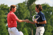 Bubba Watson and Webb Simpson shake hands on the 18th green after finishing in a tie for first place during the final round of the Zurich Classic at the TPC Louisiana on May 1, 2011 in New Orleans, Louisiana.