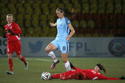 Jill Scott of Manchester City rides a tackle from Alena Nurgalieva of Zvezda 2005   during the UEFA Womens Champions League match between Zvezda 2005 and Manchester City Ladies at Zvezda Stadium on October 12, 2016 in Perm, Russia.