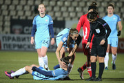 Jill Scott of Manchester City helps up an injured Jane Ross of Manchester City  during the UEFA Womens Champions League match between Zvezda 2005 and Manchester City Ladies at Zvezda Stadium on October 12, 2016 in Perm, Russia.
