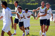 Marcelo #12 (2L) and Cristiano Ronaldo #9 (L), Segio Ramos #4 and Pepe #3 of Real Madrid celebrate with a local youth soccer player participating in the Adidas training after he scored a goal August 5, 2010 in Westwood section of Los Angeles, California.