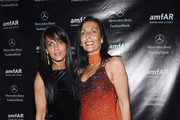 Rhonda Dergham (L) and Ghada Dergham attend the amfAR Gala after party in celebration of Mercedes-Benz Fashion Week at SL on February 6, 2013 in New York City.