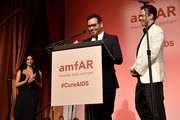 Mert Alas and Marcus Piggott accept an award onstage during the amfAR Gala New York 2019 at Cipriani Wall Street on February 06, 2019 in New York City.