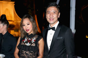 Fashion and interior design blogger Aimee Song (L) and CFO at AMTD Philip Yau attend the amfAR Gala Los Angeles 2017 at Ron Burkle's Green Acres Estate on October 13, 2017 in Beverly Hills, California.