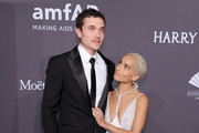 Karl Glusman (L) and Zoe Kravitz attend the amfAR New York Gala 2017 sponsored by FIJI Water at Cipriani Wall Street on February 8, 2017 in New York City.
