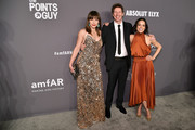 Milla Jovovich, Paul W.S. Anderson and Michelle Rodriguez attend the amfAR New York Gala 2019 at Cipriani Wall Street on February 6, 2019 in New York City.