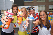 Feliciano Lopez of Spain, Elina Svitolina of Ukraine, Pat Cash of Australia and Monica Puig of Puerto Rico pose after painting street art with Melbourne graffiti artist Daniel Wenn (unseen) during the ellesse Tennis Performance Apparel Launch on January 17, 2014 in Melbourne, Australia. The new range of tennis performance apparel will be worn by Feliciano Lopez, Elina Svitolina and Monica Puig at the Australian Open.