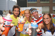 Feliciano Lopez of Spain, Elina Svitolina of Ukraine, Pat Cash of Australia and Monica Puig of Puerto Rico pose with spray cans after painting street art with Melbourne graffiti artist Daniel Wenn (unseen) during the ellesse Tennis Performance Apparel Launch on January 17, 2014 in Melbourne, Australia. The new range of tennis performance apparel will be worn by Feliciano Lopez, Elina Svitolina and Monica Puig at the Australian Open.