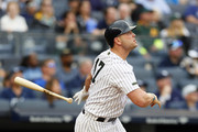 Matt Holliday #17 of the New York Yankees follows through on his home run in the 6th inning in an MLB baseball game against the Oakland Athletics on May 27, 2017 at Yankee Stadium in the Bronx borough of New York City. Yankees won 3-2. The players wore Khaki caps and accessories to honor the military during the Memorial Day weekend.