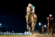 Arrogate #9 ridden by Mike Smith (red hat), wins the Dubai World Cup at Meydan Racecourse during Dubai World Cup Day on March 25, 2017 in Dubai, United Arab Emirates.