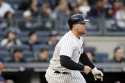 NEW YORK, NY - May 12:  Matt Holliday #17 of the New York Yankees starts to run to first after hitting the ball in an MLB baseball game against the Houston Astros on May 12, 2017 at Yankee Stadium in the Bronx borough of New York City. Astros won 5-1.