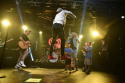 """Chris Lucas and Preston Brust of LoCash joined onstage by Bobby Bones and two young fans during iHeartMedia's Bobby Bones Book Release Party - """"FAIL UNTIL YOU DON'T: FIGHT. GRIND. REPEAT."""" on June 19, 2018 in New York City."""