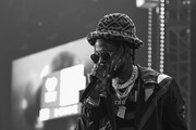 This image has been converted to black and white.) 2 Chainz performs onstage during the iHeartRadio album release party with 2 Chainz at iHeartRadio Theater on March 04, 2019 in Burbank, California.