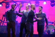 (L-R) Musicians Jonny Buckland, Chris Martin, Will Champion and Guy Berryman of Coldplay onstage at the iHeartRadio Music Festival held at the MGM Grand Garden Arena on September 23, 2011 in Las Vegas, Nevada.