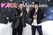 Mo' Bounce (L) and Louis Tomlinson attend the z100 All Access Lounge presented by Poland Spring Pre-Show at Pier 36 on December 13, 2019 in New York City.