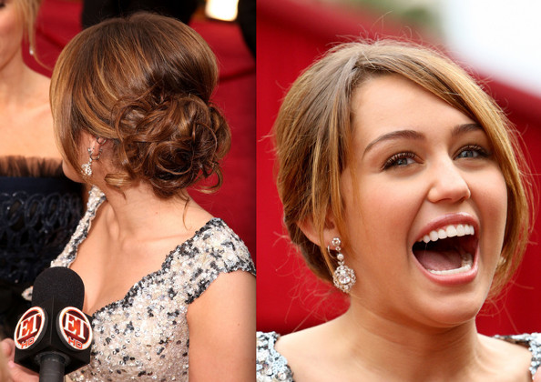 in to this curly, low bun, with her growing-out bangs framing her face.