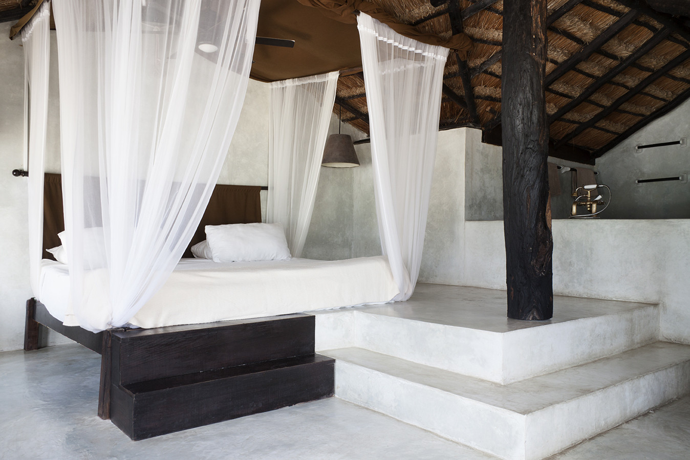 The canopy bed in a suite at Tulum's Coqui Coqui in Mexico.