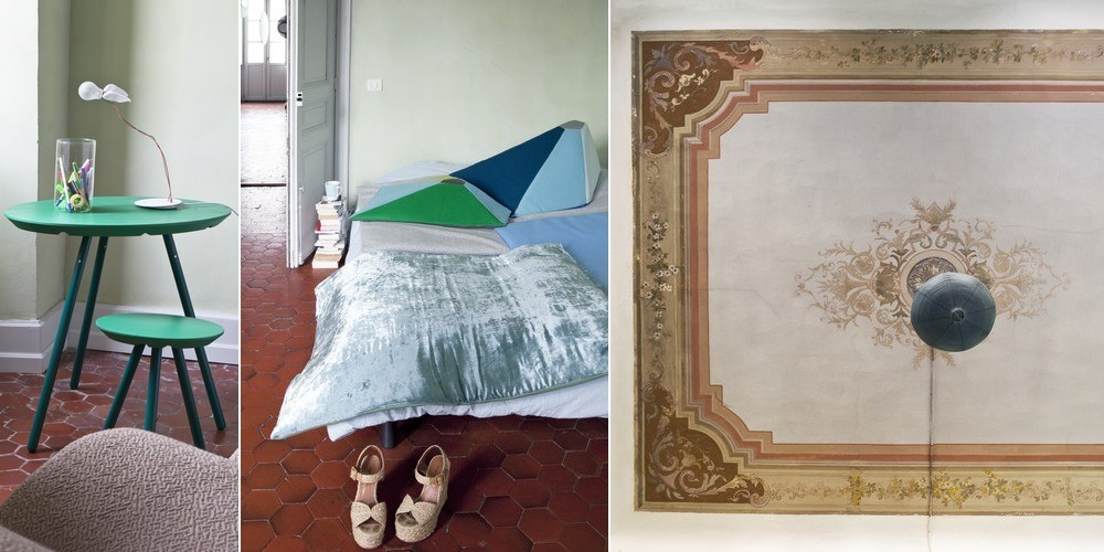 A pair of 2D Stool & Tables conceived by the designer Sebastian Bergne, which can also be hung on the wall. In the center, a brightly colored wool and velvet bedspread sits near prototypes of Marin's 'Angles' cushion. On the right, the original ceiling frescos.
