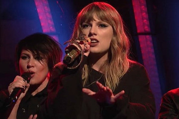 Taylor Swift Expertly Trolls Haters, Performs With Golden Snake Microphone During 'SNL'