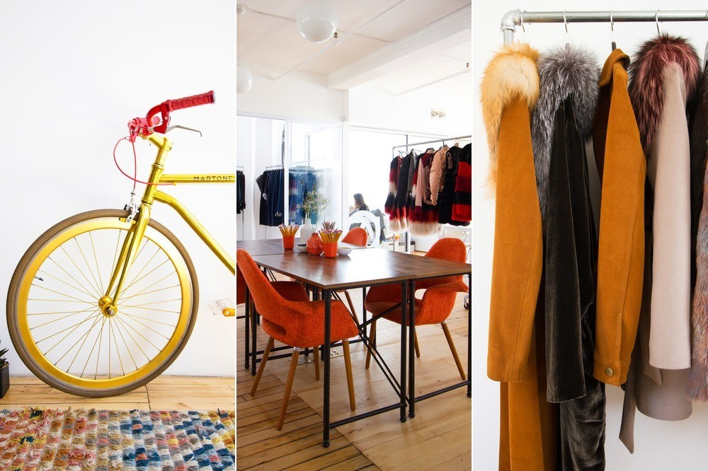 On the left is co-founder Alex Repola's brightly-hued bike by Martone Cycling Co. Center, the central meeting space features a Target table, surrounded by tomato-colored upholstered armchairs from Dot & Bo. On the right, the fall/winter 2016 offering of camel-toned jackets from ThePerfext.