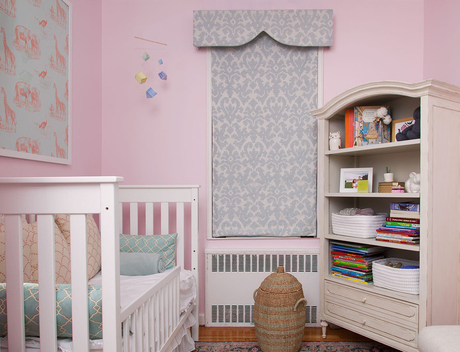 A girly, New York City nursery with a DIY pelmet box over the window