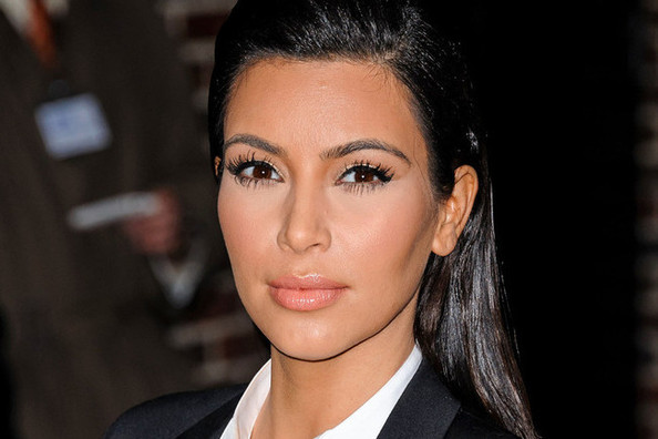 Kim Kardashian Gets Serious, Suits Up