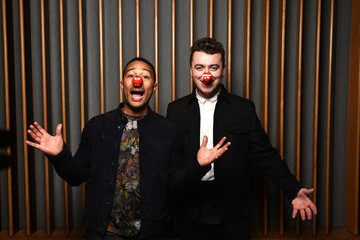 Sam Smith and John Legend Join Forces on 'Lay Me Down' for Charity